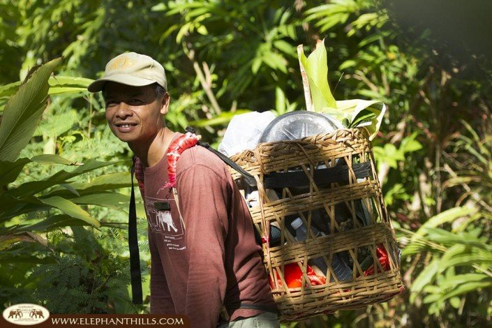 Our Elephant Hills jungle chef is delivering the fresh ingredients to our jungle kitchen to prepare a delicious lunch for our jungle trekking guests