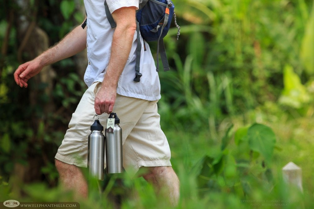 Carrying Elephant Hills reusable stainless steel bottle on activities